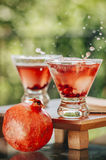 Pomegranate martinis. Served outdoors in a natural environment Stock Photo