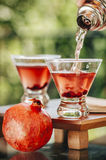 Pomegranate martinis. Served outdoors yay Stock Photography