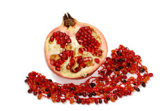 Pomegranate and necklace. Composition of pomegranate and amber necklace isolated Stock Photos