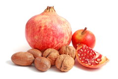 Pomegranate and nuts Stock Image