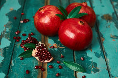 Pomegranate on the old wooden background. Rustic still life. Rustic still life. Colorful photo Royalty Free Stock Photography