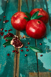Pomegranate on the old wooden background. Rustic still life. Colorful photo Stock Photo