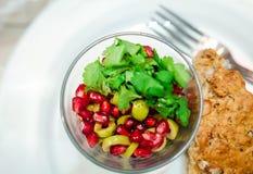 Pomegranate and olives salad Royalty Free Stock Photos