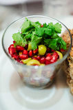 Pomegranate and olives salad Stock Images