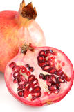 Pomegranate. One and a half pomegranate stock image