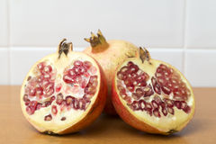 Pomegranate open in half supported on another Stock Photography