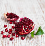 Pomegranate. Open pomegranate with seed on wooden background royalty free stock photo