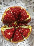 Pomegranate. An opened pomegranate showing red juicy seeds Stock Image