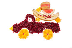 Pomegranate and orange  as shape of lorry isolated Stock Photos