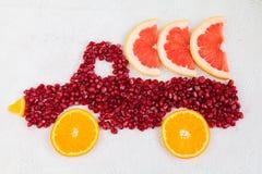 Pomegranate and orange  as shape of lorry Stock Image