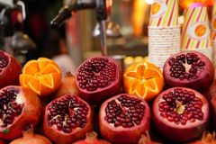 Pomegranate and orange with disposable paper cup Royalty Free Stock Photography