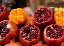 Pomegranate and orange are ready for juice extractor on the stre. Et in Istanbul Royalty Free Stock Image