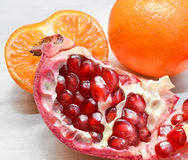 Pomegranate and orange slices closeup Royalty Free Stock Photography