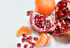 Pomegranate and orange slices closeup Royalty Free Stock Image
