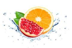 Pomegranate and orange splash Stock Image