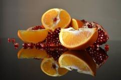 Pomegranate and orange wedges royalty free stock photo