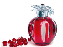 Pomegranate and perfume Royalty Free Stock Photos