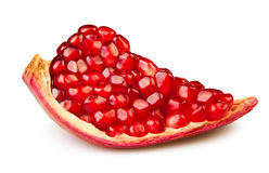Pomegranate piece. On white background Royalty Free Stock Images