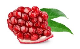 Pomegranate piece isolated on white background with clipping path and full depth of field.