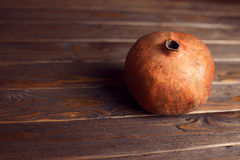 Pomegranate. Piece of  tasty and sweet pomegranate on the wooden background Stock Photo