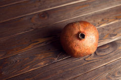 Pomegranate. Piece of  tasty and sweet pomegranate on the wooden background Royalty Free Stock Images