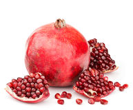 Pomegranate with pieces and grains isolated Royalty Free Stock Photos