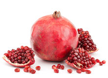 Pomegranate with pieces and grains isolated Royalty Free Stock Images