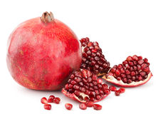 Pomegranate with pieces and grains isolated Stock Photography