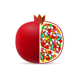 Pomegranate with pills inside Royalty Free Stock Photo