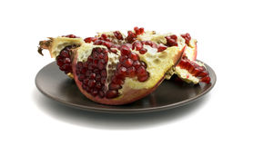 Pomegranate and plate Royalty Free Stock Photos