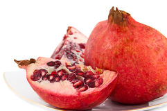 Pomegranate on plate Stock Image