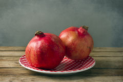 Pomegranate on plate Royalty Free Stock Photo