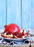 Pomegranate on a plate. Stock Photography