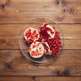 Pomegranate on a plate Royalty Free Stock Images