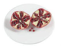 Pomegranate on a plate, cut in half Stock Photography