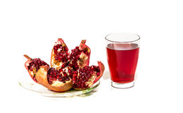 Pomegranate and pomegranate juice Stock Images