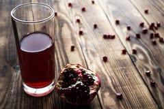 Pomegranate and pomegranate juice Royalty Free Stock Photo