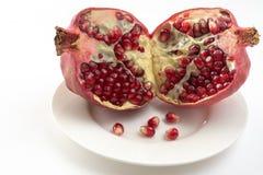 Pomegranate and pomegranate seeds stock image