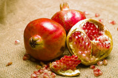 Pomegranate (Punica granatum). Pomegranete on natural brown sheet Royalty Free Stock Photo