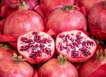 Pomegranate Red Fruit Stuck, opened and showing their Seeds, on Market stock photos