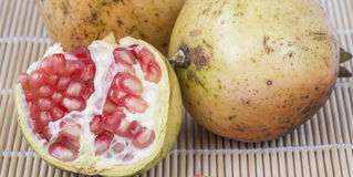 Pomegranate. And red seeds closeup on the table Royalty Free Stock Image