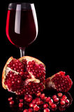 Pomegranate and red wine Stock Photography