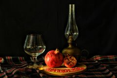 Pomegranate with retro tableware