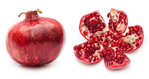 Pomegranate. Ripe and broken pomegranate fruit with seed isolated on white background royalty free stock photography
