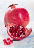 Pomegranate. Ripe juicy pomegranate on a blue background stock image