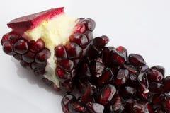 Pomegranate. Ripe pomegranate seeds on light background Stock Photo