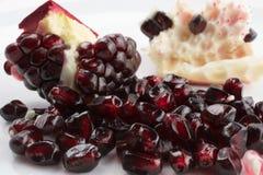 Pomegranate. Ripe pomegranate seeds on light background Royalty Free Stock Images