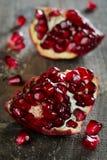 Pomegranate. Ripe pomegranate on a wooden board stock photo