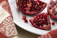 Pomegranate  Sectioned in Closeup Stock Images