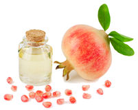 Pomegranate Seed Oil. Pomegranate with leaves on a white background Stock Photography